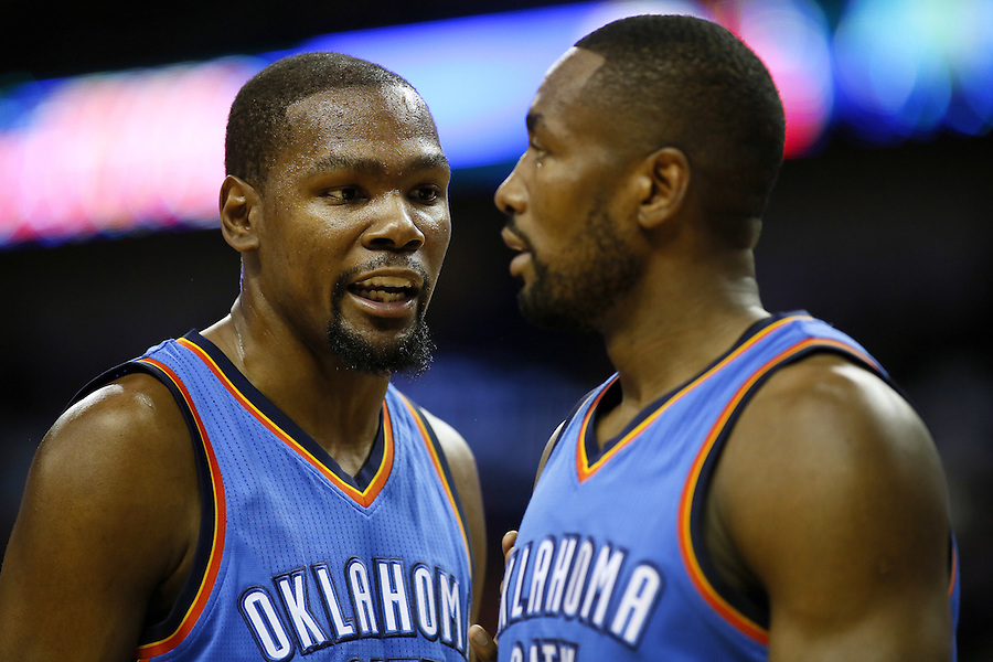 Oklahoma City Thunder forward Kevin Durant, left, talks to forward Serge Ibaka during the first half of an NBA basketball game Thursday, Feb. 25, 2016, in New Orleans. (AP Photo/Jonathan Bachman)
