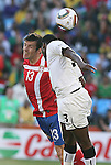 13 JUN 2010:  Asamoah Gyan (GHA)(3) and Aleksandar Lukovic (SRB)(13) compete for a head ball.  The Serbia National Team played the Ghana National Team at Loftus Versfeld Stadium in Tshwane/Pretoria, South Africa in a 2010 FIFA World Cup Group D match.