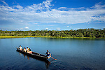 Boats with visitors touring the Amazon River in Ecuador