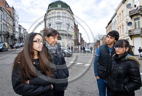 VERVIERS - BELGIUM - 16 January 2015 -- Belgium police anti-terror raid in VerviersTursday evening - 2 suspects killed one arrested. -- (2nd. left) Louise Rioux and her children Colyne (14) and Yannick (22) with his sister Stacy (18). Louise could not enter her home during the whole night after going to the supermarket just before the raid. Her children were home alone during the shoot-out and Yannick filmed through his window, later police arresting people from the raided house.  -- PHOTO: Juha ROININEN / EUP-IMAGES