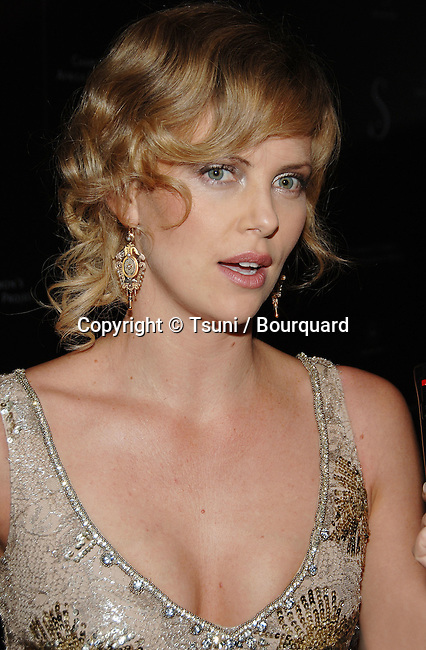 Charlize Theron  arriving at the Social Hollywood to benefit Charlize Theron Africa Outreach Program  In Los Angeles. June 27, 2006.