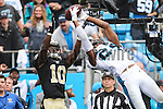 September 27, 2015: Carolina Panthers cornerback Josh Norman (24) makes the saving catch over New Orleans Saints wide receiver Brandin Cooks (10) in the second half  between the New Orleans Saints and the Carolina Panthers at Bank of America Stadium in Charlotte, NC. Panthers win over the Saints 27-22. (Photo by Jim Dedmon/Icon Sportswire).