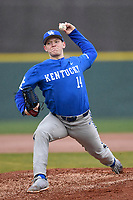 Starting pitcher Zack Thompson (14) of the Kentucky Wildcats delivers a pitch in a game in the rain against the University of South Carolina Upstate Spartans on Saturday, February 17, 2018, at Cleveland S. Harley Park in Spartanburg, South Carolina. Kentucky won, 6-5, in 10 innings. (Tom Priddy/Four Seam Images)