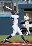 February 24, 2012:   Nevada Wolf Pack catcher Carlos Escobar bats against the Utah Valley Wolverines during  their NCAA baseball game played at Peccole Park on Friday afternoon in Reno, Nevada.