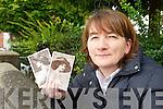 Linda Drugan with old Postcards.
