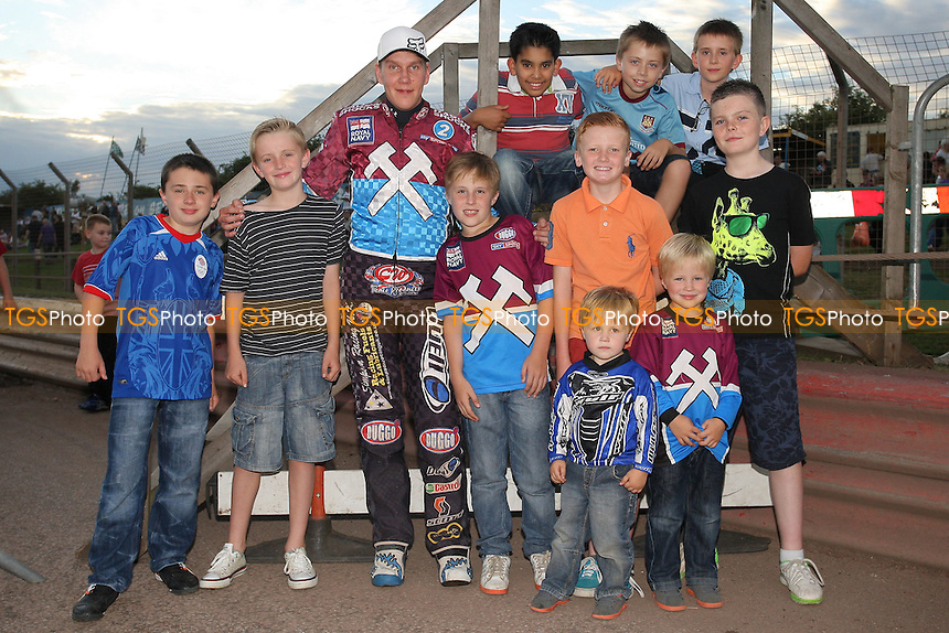 Kauko Nieminen poses for a photo with fans ahead of the meeting - Lakeside Hammers vs Eastbourne Eagles - Sky Sports Elite League Speedway at Arena Essex Raceway, Purfleet - 17/08/12 - MANDATORY CREDIT: Gavin Ellis/TGSPHOTO - Self billing applies where appropriate - 0845 094 6026 - contact@tgsphoto.co.uk - NO UNPAID USE.