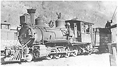 3/4 view of RGS 2-8-0 #42 taking water at Rico.  The tender has Sunrise lettering.<br /> RGS  Rico, CO  Taken by Kelley, Frank O. - 7/9/1942
