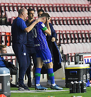Wigan Athletic's Joe Williams is comforted by Manager Paul Cook<br /> <br /> Photographer Dave Howarth/CameraSport<br /> <br /> The EFL Sky Bet Championship - Wigan Athletic v Fulham - Wednesday July 22nd 2020 - DW Stadium - Wigan<br /> <br /> World Copyright © 2020 CameraSport. All rights reserved. 43 Linden Ave. Countesthorpe. Leicester. England. LE8 5PG - Tel: +44 (0) 116 277 4147 - admin@camerasport.com - www.camerasport.com