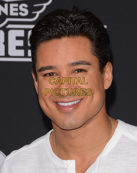 15 July 2014 - Hollywood, California - Mario Lopez. Arrivals for the premiere of Disney's &quot;Planes: Fire and Rescue&quot; held at the El Capitan Theater in Hollywood, Ca. <br /> CAP/ADM/BT<br /> &copy;BT/ADM/Capital Pictures