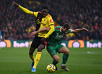 1st January 2020; Vicarage Road, Watford, Hertfordshire, England; English Premier League Football, Watford versus Wolverhampton Wanderers; Ismaila Sarr of Watford competes for the ball with Jonny of Wolverhampton Wanderers - Strictly Editorial Use Only. No use with unauthorized audio, video, data, fixture lists, club/league logos or 'live' services. Online in-match use limited to 120 images, no video emulation. No use in betting, games or single club/league/player publications