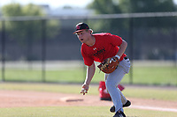 Dylan Simmons (20) of Trinity Christian Academy in Jacksonville, Florida during the Under Armour Baseball Factory National Showcase, Florida, presented by Baseball Factory on June 13, 2018 the Joe DiMaggio Sports Complex in Clearwater, Florida.  (Nathan Ray/Four Seam Images)