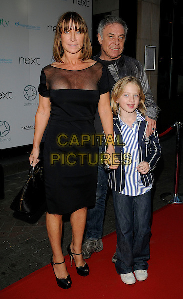 MEG MATTHEWS & FAMILY .at Jackie Brambles leaving party, Zebrano bar, Ganton Street, London, England 3rd August 2009.full length black dress daughter Anais gallagher guest sheer see through bag shoes peep toe YSL platforms tribute .CAP/CAN.©Can Nguyen/Capital Pictures