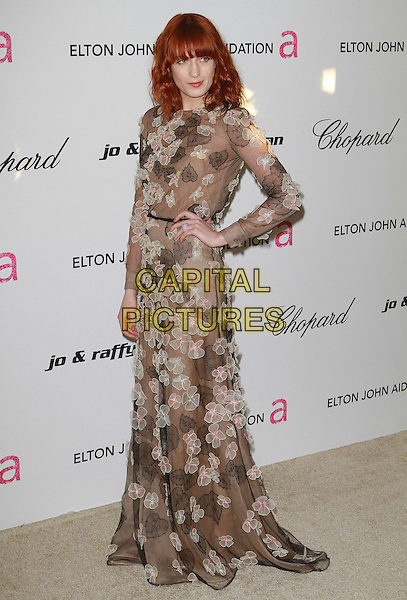 FLORENCE WELCH of Florence and the Machine .19th Annual Elton John AIDS Foundation Academy Awards Viewing Party held at The Pacific Design Center, West Hollywood, California, USA..February 27th, 2011.oscars full length sheer black white leaves leaf dress flowers floral applique long sleeve sheer maxi hand on hip .CAP/ADM/FS.©Faye Sadou/AdMedia/Capital Pictures.
