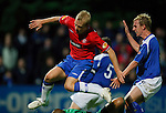 Steven Naismith taps the ball past keeper Ludovic Roy to open the scoring