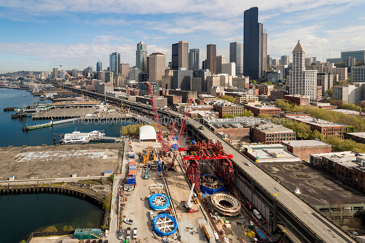 4/8/2015&mdash;Seattle, WA<br /> <br /> &ldquo;Bertha&rdquo; the nickname for Seattle&rsquo;s tunnel boring machine, lies in pieces next to the viaduct the tunnel is supposed to replace.<br /> <br /> The Alaskan Way Viaduct replacement tunnel is a bored road tunnel that is under construction in the city of Seattle in the U.S. state of Washington. The project has been stalled since December 2013. No firm date for if/when the project will continue has been set.[3] The 2-mile (3.2 km) tunnel would carry State Route 99 under Downtown Seattle from the SoDo neighborhood to South Lake Union in the north.<br /> <br /> Since 2001, the proposed replacement of the Alaskan Way Viaduct has been the source of much political consternation demonstrating the Seattle process. Options for the structure, which carries 110,000 vehicles per day, included either replacing it with a cut-and-cover tunnel, replacing it with another elevated highway, or eliminating it while improving other surface streets and public transportation. The current plan emerged in 2009 when government officials agreed to a deep-bore tunnel.<br /> <br /> Photograph by Stuart Isett<br /> &copy;2014 Stuart Isett. All rights reserved.