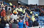 Supporters are moved from a section of the Broomloan Road stand due to a problem with the stadium roof prior to kick-off
