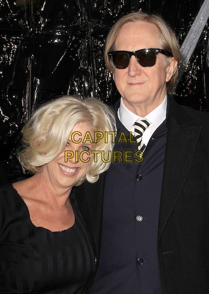 "T BONE BURNETT (Joseph Henry ""T-Bone"" Burnett) & wife .""Crazy Heart"" - Los Angeles Premieres held Academy of Motion Picture Arts and Sciences, Beverly Hills, California, USA..December 8th, 2009.half length sunglasses black tie couple husband .CAP/ADM/KB.©Kevan Brooks/AdMedia/Capital Pictures."