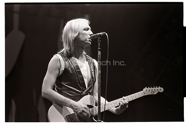 Tom Petty performing at Poplar Creek Music Theatre in Hoffman Estates , Illinois during the Rock and Roll Caravan Tour on June 21, 1987. Credit: Gene Ambo/MediaPunch