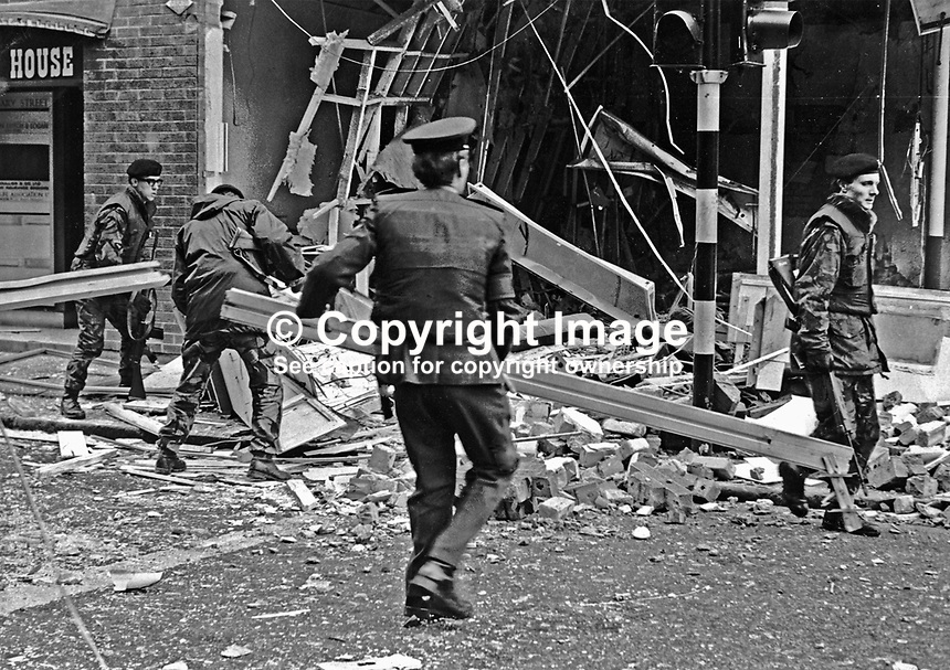 The target for this Provisional IRA bomb attack was the British European Airways Office, Castle Street, Belfast, N Ireland. Soldiers and police clear the debris from the street to allow traffic to resume. BEA was later absorbed into the present day British Airways. 17th February 1972. 197202170108<br />