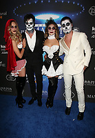 LOS ANGELES, CA - OCTOBER 21: Peta Murgatroyd, Maksim Chmerkovskiy, Valentin Chmerkovskiy, Guest, at 2017 MAXIM Halloween Party at LA Center Studios in Los Angeles, California on October 21, 2017. Credit: Faye Sadou/MediaPunch /NortePhoto.com