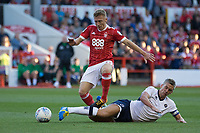 Steve Morison of Millwall tackles Ben Osborn of Nottingham Forest during the Sky Bet Championship match between Nottingham Forest and Millwall at the City Ground, Nottingham, England on 4 August 2017. Photo by James Williamson / PRiME Media Images.
