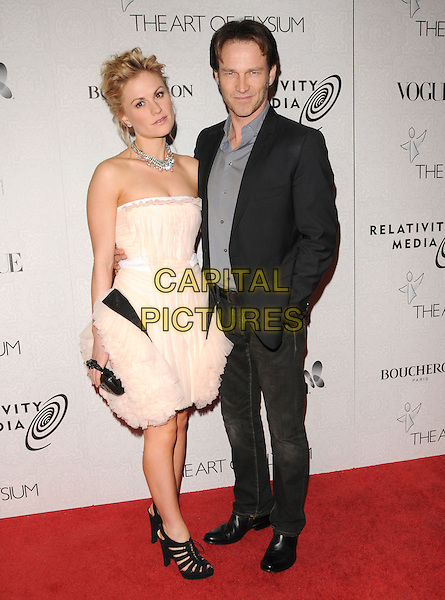 """ANNA PAQUIN & STEPHEN MOYER .at Art of Elysium 3rd Annual Black Tie charity gala '""""Heaven"""" held at 990 Wilshire Blvd in Beverly Hills, California, USA, January 16th 2010 .                                                                  arrivals full length cream beige nude dress strapless black shoes sides structured peep toe cut out clutch bag grey gray shirt suit couple engaged fiance jeans .CAP/RKE/DVS.©DVS/RockinExposures/Capital Pictures"""