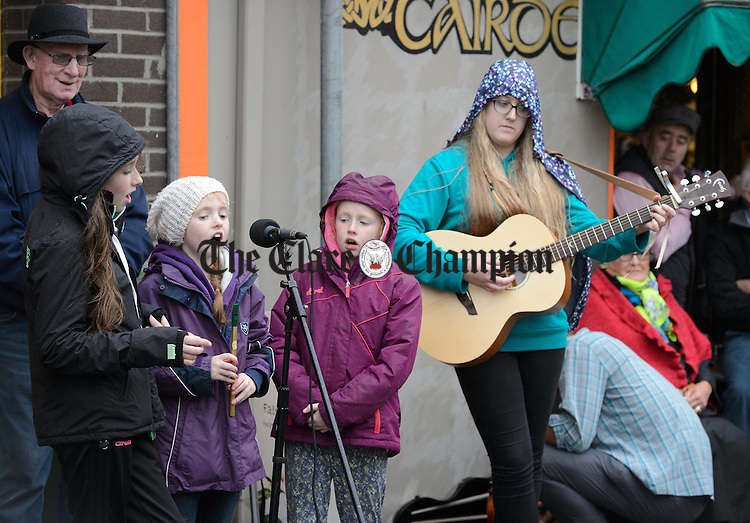 Sisters; Anna, Jane and Kate Mulvey of Westmeath join The  Dying Kicks who were playing at Barrack street during Fleadh Cheoil na hEireann in Ennis. Photograph by John Kelly.