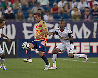 Monarcas Morelia forward Luis Gabriel Rey (18) passes the ball as New England Revolution defender Darrius Barnes (25) closes. Monarcas Morelia defeated the New England Revolution, 2-1, in the SuperLiga 2010 Final at Gillette Stadium on September 1, 2010.