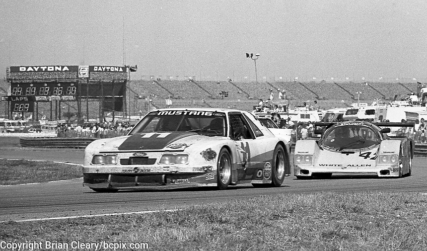 The #11 Mustang of Scott Pruett, Lyn St. James, Bill Elliott, and Tom Gloy  leads the #42 Fabcar CL FGTP-701/Porsche of Chip Mead, James King, John Higgins, and Howard Cherry during the Rolex 24 at Daytona, Daytona International Speedway, Daytona Beach, FL, February 1, 1987.  (Photo by Brian Cleary/www.bcpix.com)