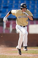 Austin Stadler #9 of the Wake Forest Demon Deacons hustles down the first base line versus the Xavier Musketeers at Wake Forest Baseball Park March 7, 2010, in Winston-Salem, North Carolina.  Photo by Brian Westerholt / Four Seam Images