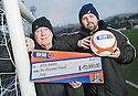 "Alloa Manager Paul Hartley and Head of Youth Graeme Liveston, who was his former teacher, with their ""Cans For Youth Teams"" cheque."