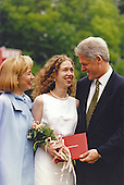 United States President Bill Clinton, right, and first lady Hillary Rodham Clinton, left, attend Chelsea Clinton's high school graduation on June 6, 1997 at the Sidwell Friends School in Washington, D.C.  Following her graduation Chelsea Clinton attended Stanford University.<br /> Mandatory Credit: Sharon Farmer / White House via CNP