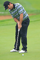 Francesco Molinari (ITA) putts on the 9th green during Thursday's Round 1 of the 2014 BMW Masters held at Lake Malaren, Shanghai, China 30th October 2014.<br /> Picture: Eoin Clarke www.golffile.ie