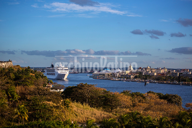 Cruise ship MSC opera leaves the bay of Havana passing infront the Malecon and the Old City. In a tourist boom never seen , 4 million of foreigners visited Cuba during 2016.