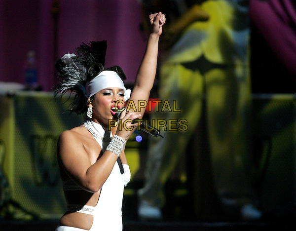 ALICIA KEYS.Performing to a sold out crowd at The Kodak Theatre in Hollywood, California..March 16th, 2005.half length white  cut out cut away headband  bracelet halterneck singing  .www.capitalpictures.com.sales@capitalpictures.com.Supplied By Capital PIctures
