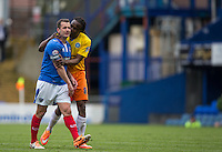 Marcus Bean of Wycombe Wanderers has a friendly word with Michael Doyle of Portsmouth during the Sky Bet League 2 match between Portsmouth and Wycombe Wanderers at Fratton Park, Portsmouth, England on 23 April 2016. Photo by Andy Rowland.