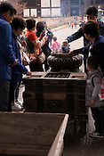 Chinese tourists lighting incense in front of Todaiji Temple.