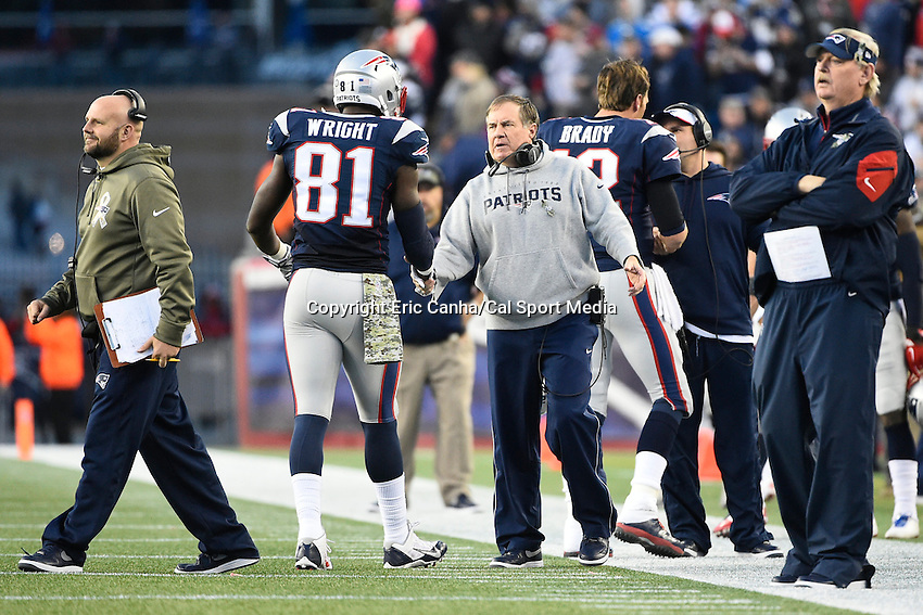 November 23, 2014 - Foxborough, Massachusetts, U.S.- New England Patriots head coach Bill Belichick shakes New England Patriots tight end Timothy Wright's (81) hand as he comes off the field during the NFL game between the Detroit Lions and the New England Patriots held at Gillette Stadium in Foxborough Massachusetts. The Patriots defeated the Lions 34-9. Eric Canha/CSM