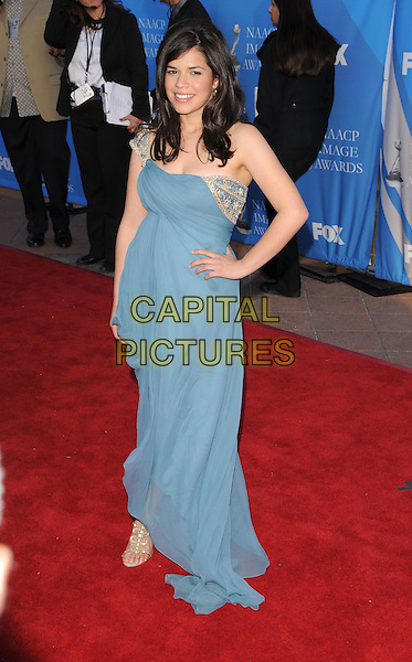 AMERICA FERRERA .Attends The 39th NAACP Image Awards held at The Shrine Auditorium in Los Angeles, California, USA..February 14th, 2008        .full length blue dress hand on hip gold detail sheer .CAP/DVS.©Debbie VanStory/Capital Pictures.