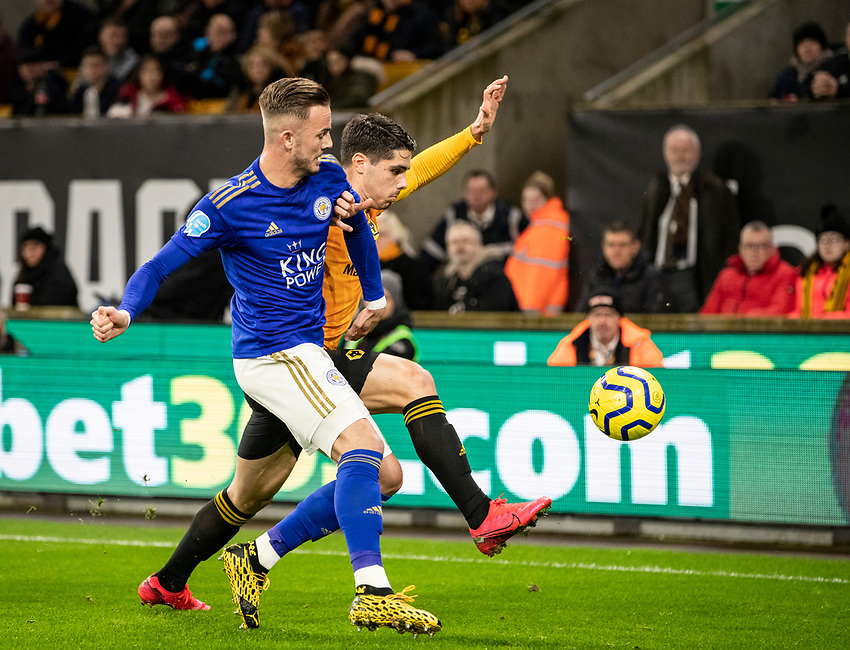Leicester City's James Maddison (left) competing with Wolverhampton Wanderers' Pedro Neto <br /> <br /> Photographer Andrew Kearns/CameraSport<br /> <br /> The Premier League - Wolverhampton Wanderers v Leicester City - Friday 14th February 2020 - Molineux - Wolverhampton<br /> <br /> World Copyright © 2020 CameraSport. All rights reserved. 43 Linden Ave. Countesthorpe. Leicester. England. LE8 5PG - Tel: +44 (0) 116 277 4147 - admin@camerasport.com - www.camerasport.com