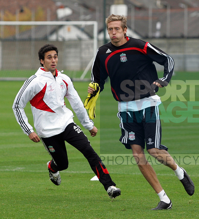 Liverpool Champions League Training, Melwood Training Complex, West Derby, Liverpool, 5th November 2007...Alvaro Arbeloa (L) chases team-mate Peter Crouch.