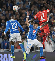 BOGOTA - COLOMBIA, 10-12-2017: Felipe Banguero (Izq) y Juan Guillermo Dominguez (C) jugadores de Millonarios disputan el balón con Olmes Garcia (Der) jugador de America de Cali durante partido por la semifinal vuelta de la Liga Aguila II 2017 jugado en el estadio Nemesio Camacho El Campin de la ciudad de Bogotá. / Felipe Banguero (L) and Juan Guillermo Dominguez (C) players of Millonarios fight for the ball with Olmes Garcia (R) player of America de Cali during second leg match for the semifinal of the Liga Aguila II 2017 played at the Nemesio Camacho El Campin Stadium in Bogota city. Photo: VizzorImage / Gabriel Aponte / Staff.