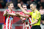 Atletico de Madrid's Gabi Fernandez (l) and Diego Godin have words with the Spanish referee Santiago Jaime Latre during Spanish Kings Cup, Quarter finals, first leg match. January 17,2018. (ALTERPHOTOS/Acero)