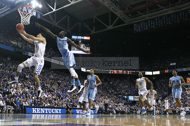 Guard Devin Booker of the Kentucky Wildcats goes for a layup during the second half of game against  the North Carolina Tar Heels at Rupp Arena on Saturday, December 13, 2014 in Lexington, Ky. Kentucky defeated North Carolina 84-70. Photo by Michael Reaves | Staff