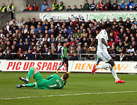 SWANSEA, WALES - FEBRUARY 21:Bafetimbi Gomis of Swansea jumps over David De Gea of Manchester United during the Barclays Premier League match between Swansea City and Manchester United at Liberty Stadium on February 21, 2015 in Swansea, Wales.