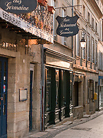 Restaurants line a street of Saint Emilion, France