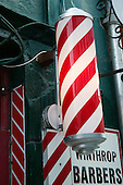 Traditional red and white pole of Barber shop.