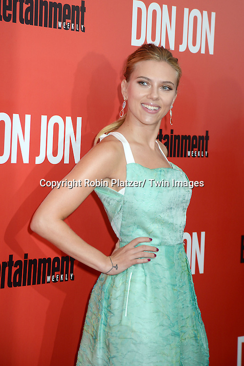 "Scarlett Johansson in Roland Moret green dress attends the ""Don Jon"" New York Movie Premiere on September 12, 2013 at the SVA Theatre in New York City."