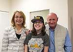 Garden City, New York, USA. April 17, 2016. L-R, GABBY GIFFORDS, former United States Congresswoman; volunteer EMMA MOGAVERO, 18, of Jericho; and Gifford's husband MARK KELLY, former NASA astronaut, pose for a photograph after Giffords and Kelly spoke about the importance of GOTV, Getting Out The Vote for Hillary Clinton - including because of Clinton's strong position on stricter gun control legislation - at the Canvass Kickoff at the Nassau County Democratic Office in Garden City. Giffords survived an assassination attempt near Tuscon, Arizona, during her first 'Congress on Your Corner' event in January 2011. Kelly commanded the final flight of the Space Shuttle Endeavor in May 2011. Mogavero wore a 'Be Yourself' shirt with terms such as 'genderfluid' and 'agender' printed on it.