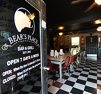NWA Democrat-Gazette/ANDY SHUPE<br /> The front door of Bear's Place features the bar and restaurant's hours Thursday, May 25, 2017, in south Fayetteville.